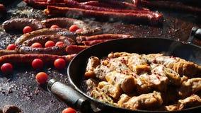 Kochen von Würsten und von Kohlrollen stock video footage