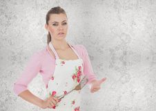 Kochfrau mit Abstreicheisen Stockfotos