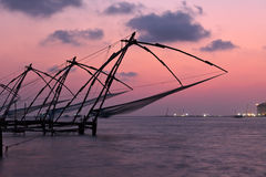 Chinese fishnets on sunset. Kochi, Kerala, India Stock Photo