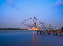 Kochi chinese fishnets in twilight in Kochi, Kerala. Stock Photo