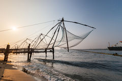 Kochi, India. Chinese fishing nets. Chinese fishnets on sunset. Kochi, Kerala, India Stock Photos