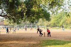 Cricket game. Sports in Kochi, India. Kochi, India - November 29, 2015: Men playing sport game on a field, in teams. Since colonial times cricket has became the royalty free stock images
