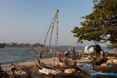 KOCHIN, INDIA-FEBRUARY 24: Fishermen on the city port on Februar Stock Image