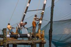 KOCHIN, INDIA-FEBRUARY 24: Fishermen on the city port on Februar Stock Images