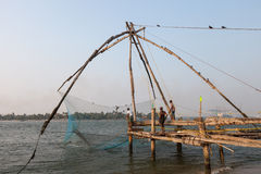 KOCHIN, INDIA-FEBRUARY 24: Fishermen on the city port on Februar Stock Photo