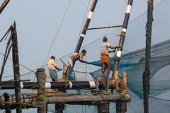 KOCHIN, INDIA-FEBRUARY 24: Fishermen on the city port on Februar Stock Photos