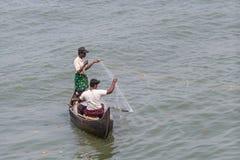 KOCHIN, INDIA-FEBRUARY 24: Fishermen on the city port on Februar Royalty Free Stock Photos