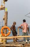 KOCHIN, INDIA-FEBRUARY 24: Fishermen on the city port on Februar Royalty Free Stock Image