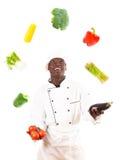 Kock Juggling With Vegetables Royaltyfria Bilder