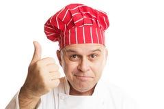 Kock med den röda hatten som gör uttryck arkivbild