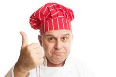 Kock med den r?da hatten som g?r uttryck arkivfoton