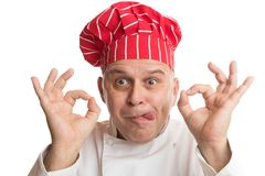 Kock med den r?da hatten som g?r uttryck royaltyfria bilder