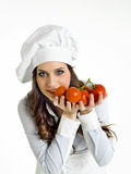Kock med italienska tomater Royaltyfri Foto