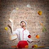 Kock på kök Fotografering för Bildbyråer
