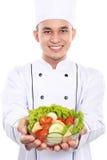 Kock som ler med sallad royaltyfri fotografi