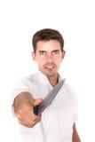 Kock som pekar med kniven Arkivbild