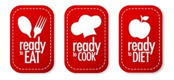 kocken bantar äter klara etiketter till Arkivfoto