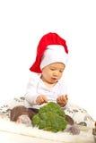 Kocken behandla som ett barn med broccoli Arkivbilder