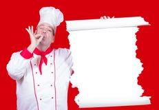 kocken erbjuder en meny Arkivbild