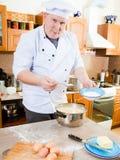 kockkökman Fotografering för Bildbyråer