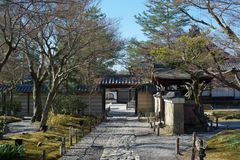 Kodaiji Temple, Kyoto, Japan. View of the raked garden at Kodai-ji in winter, through the gate. Kodaiji is a magnificent zen buddhist temple situated in Stock Photography