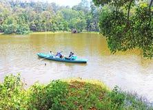 Kodaikanal lake tamil nadu india. People rowing a boat at hill station scenic lake Stock Image