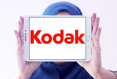 Kodak logo. Logo of camera manufacturer kodak on samsung tablet holded by arab muslim woman Royalty Free Stock Photo