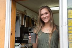 Female barista at Island Espresso Cafe, Kodiak. Royalty Free Stock Image