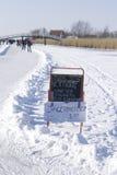 `Koek en Sopie` blackboard in the snow Royalty Free Stock Images