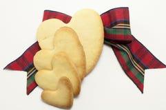 Koekjes en geruite Schotse wollen stofboog Stock Foto
