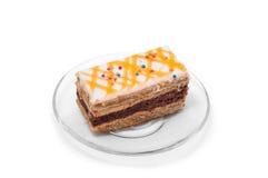 Koekjescake met oranje room op plaat Stock Fotografie