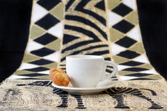 Koeksisters, traditional South African fried cooki. Delicious homemade South African cookies, fried and dipped in syrup. Placed with a coffee cup on a table Stock Images