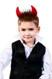 Koel weinig jongen in een vest stock foto