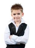 Koel weinig jongen in een vest stock afbeelding