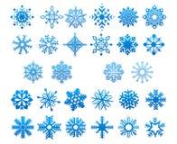 Koele blauwe geplaatste sneeuwvlokken Stock Afbeelding