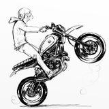 Koele jongen die extreme motorfiets berijden Royalty-vrije Stock Afbeeldingen