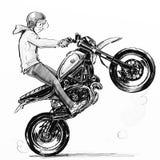 Koele jongen die extreme motorfiets berijden Stock Foto
