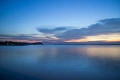 Koele zeegezichtzonsondergang stock afbeeldingen