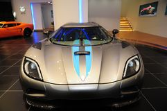 A Koenigsegg Agera supercar display at  Auto Show. A Koenigsegg Agera supercar car was exhibited at Guangzhou Auto Show in Guangzhou International Convention & Royalty Free Stock Images