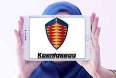 Koenigsegg cars logo. Logo of Koenigsegg cars brand on samsung tablet holded by arab muslim woman Royalty Free Stock Images