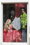 Barbie girl and Elvis man. KOETHEN, GERMANY - CIRCA MARCH 2016: Barbie girl and Elvis man dress on display in a shop window stock photo