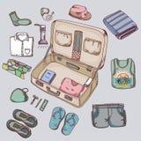 Koffer die met dingen zich voor het reizen kleden Stock Foto's