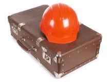 Koffer en helm Stock Afbeelding