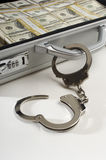 Koffer met Dollars en Handcuffs Stock Fotografie