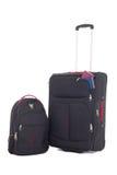 Koffer met paspoorten en rugzak op witte backgroun wordt geïsoleerd die Stock Afbeeldingen
