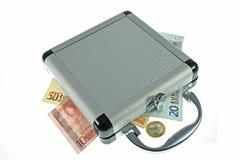Koffer mit Geld Stockbilder