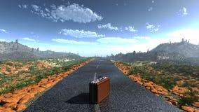 Koffer op een verlaten weg Stock Afbeelding