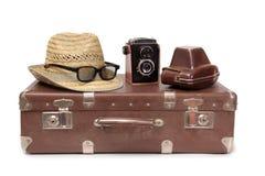 Koffer und Retro- Kamera drei Stockfotos
