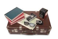 Koffer und Retro- Kamera neun Lizenzfreies Stockbild