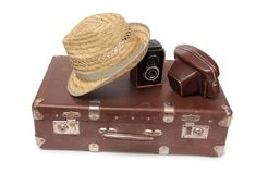 Koffer und Retro- Kamera vier Stockfoto